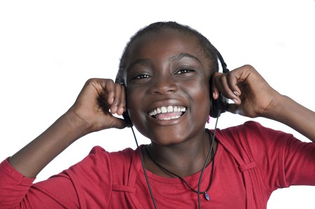 African girl with headphones listening to music, Studio Shot photo