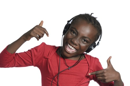 music therapy: African girl with headphones listening to music, Studio Shot