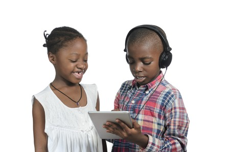 Two african kids with Tablet PC, Studio Shot photo