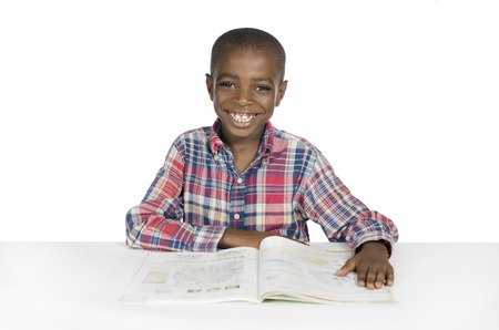African Boy with Text Book, Studio Shot photo