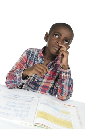 African boy thinking with text book, Studio Shot photo
