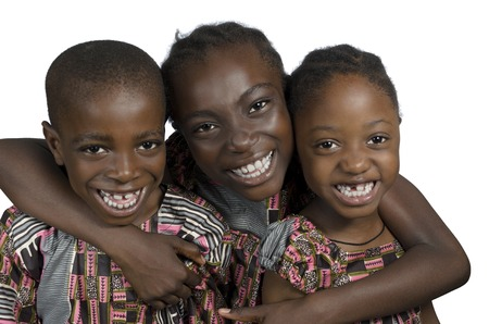 Three african kids holding on another smiling, Studio Shot Stock Photo - 24404017