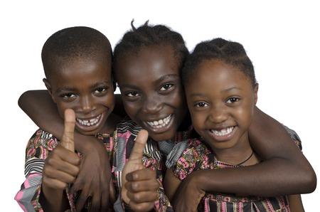 Three african kids holding thumbs up, Studio Shot photo
