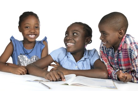 Three african kids learning together, Studio Shot