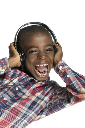 music therapy: African boy with headphones listening to music, Studio Shot