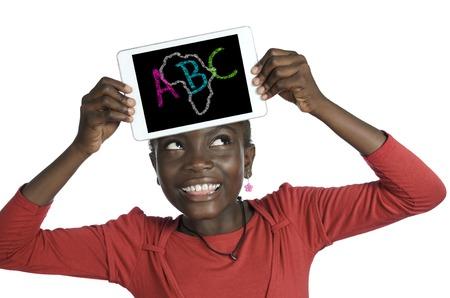 Afrikaans Meisje bedrijf minitablet PC, ABC Illustratie, Studiofoto Stockfoto