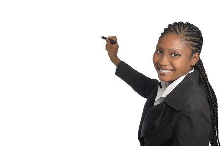 african business woman: African business woman writing in free copy space, Studio Shot Stock Photo