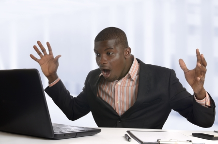 winning stock: Surprised african business man with notebook, Studio Shot Stock Photo