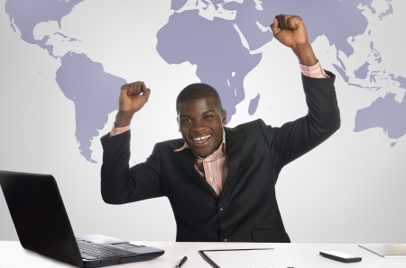 jubilation: African business man jubilating in office, Studio Shot