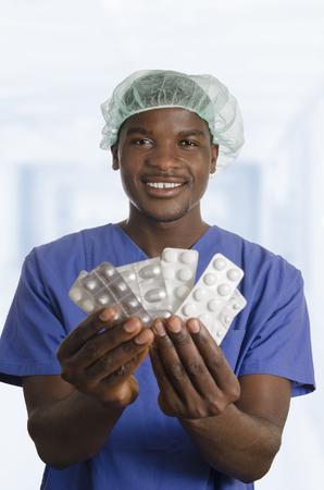 nursing unit: African Doctor with Pills, Studio Shot