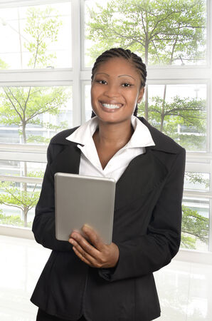 African business woman with Tablet PC, Studio Shot photo