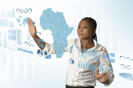 scientists: African business woman working on virtual touchscreen, Studio Shot