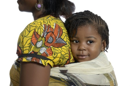 black empowerment: African woman carrying child on back, Studio Shot