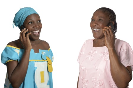 black empowerment: African mother and daughter talking on cellphone, Studio Shot