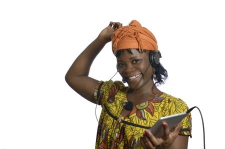African woman listening music with tablet PC, Studio Shot photo