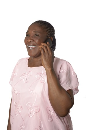 African senior grandmother with cellphone, Studio Shot photo