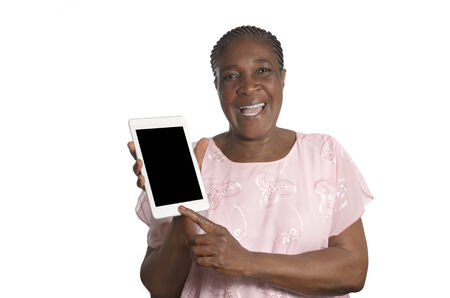Senior african woman with tablet PC, Studio Shot photo