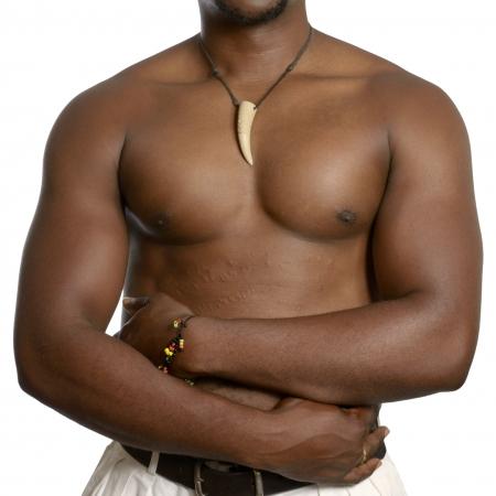 Muscular african man with medical scarification on abdomen, Studio Shot photo