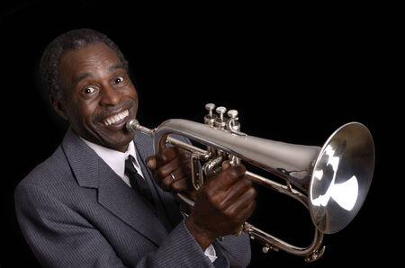 flugelhorn: Afroamerican Jazz Musician with Flugelhorn smiling, Studio Shot Stock Photo