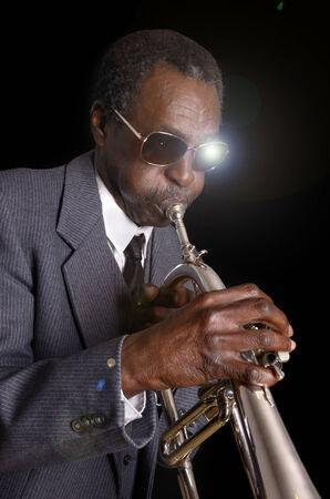 flugelhorn: Afroamerican Jazz Musician with Flugelhorn, Studio Shot Stock Photo