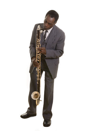 Afroamerican Jazz Musician with Bass Clarinet, Studio Shot photo