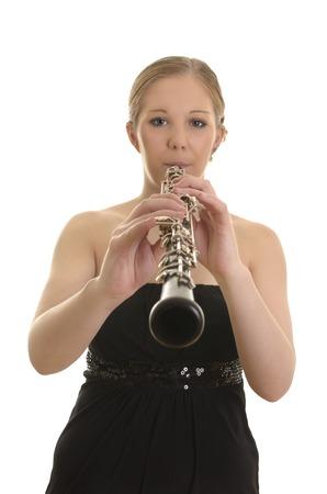 oboe: Pretty young woman playing Oboe, Studio Shot  Stock Photo