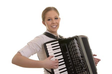 acordeón: Mujer bastante joven que toca el acordeón, Foto de estudio