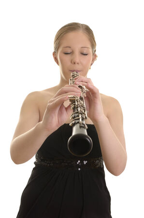 oboe: Pretty young woman playing Oboe, Studio Shot  Stock Photo