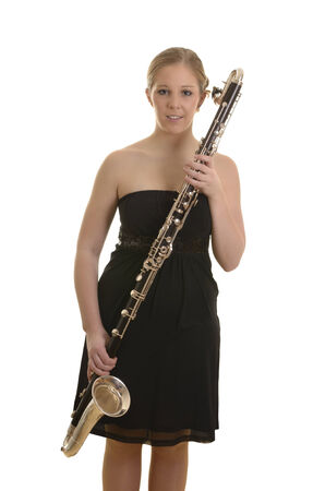 Pretty blonde woman in evening dress with bass clarinet, Studio Shot photo