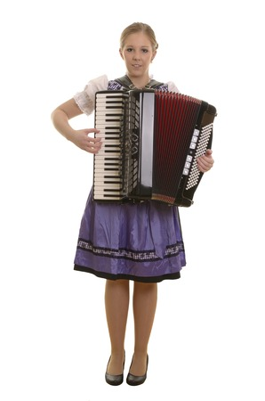 harmonica: Pretty young drindl woman playing accordion , Studio Shot Stock Photo