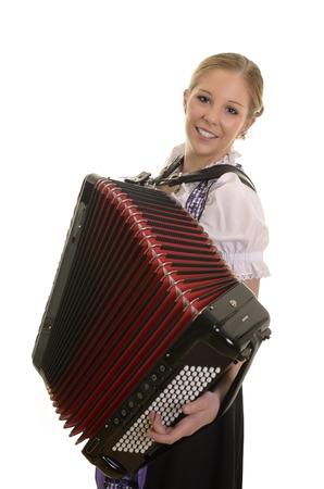 Pretty young drindl woman playing accordion , Studio Shot Stock Photo