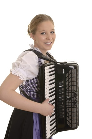 Pretty young drindl woman playing accordion , Studio Shot photo