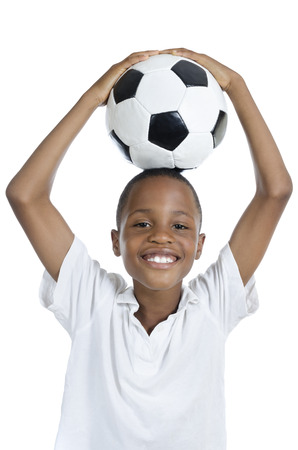 fairplay: African Boy with Football smiling, Studio Shot, Isolated