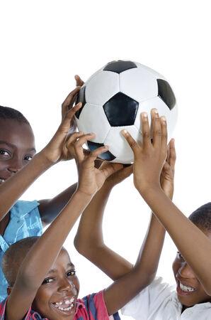 fairplay: Happy african kids holding football , Studio Shot, Isolated Stock Photo