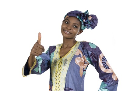 black empowerment: Pretty african woman in traditional clothes thumb up, Studio Shot, Cameroon