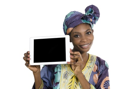 black empowerment: Pretty african woman with tablet PC, free copy space, Studio Shot, Cameroon