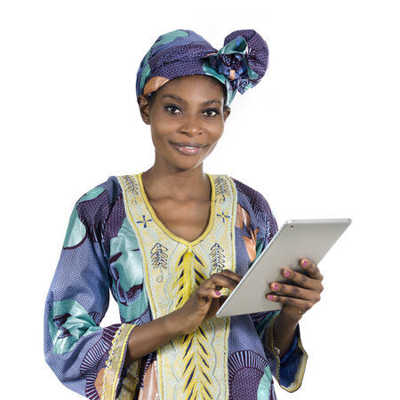 Pretty african woman with tablet PC, Studio Shot, Cameroon Stock Photo