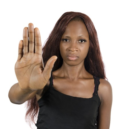 African woman showing hand to say NO!, Studio Shot, Cameroon Stock Photo