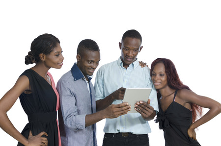 Four african young people with tablet PC having fun, Studio Shot, Isolated photo