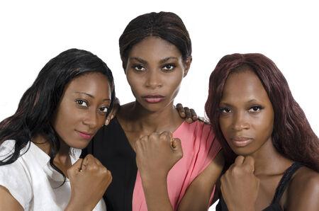 black empowerment: Three african women showing fists, Studio Shot, Isolated Stock Photo