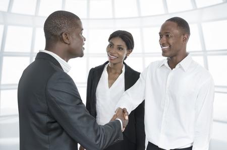 african american handshake: Three african business people handshake, Studio Shot, Cameroon