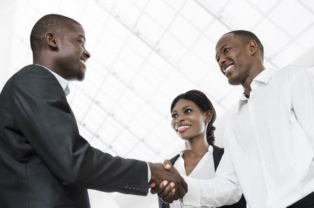 africa american: Three african business people handshake, Studio Shot, Cameroon