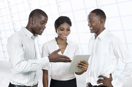 Three african business people with tablet PC, Studio Shot