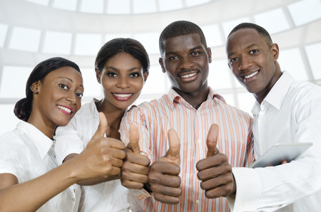 For african business partners  students thumb up, Studio Shot