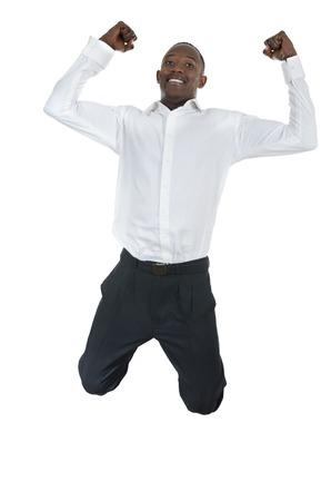 belleza masculina: Hermoso Hombre africano que salta arriba, Foto de estudio Foto de archivo