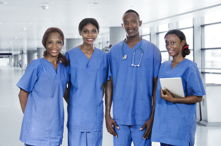 nursing staff: African physician team with tablet PC, Studio Shot Stock Photo