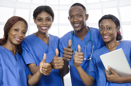 African physician team thumbs up, Studio Shot
