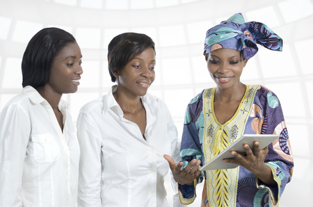 Three african business women with tablet PC, Studio Shot