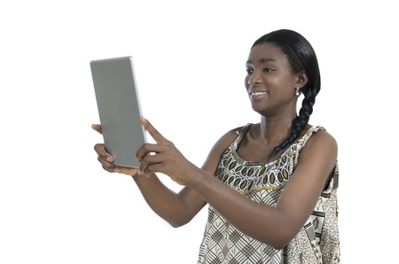 African woman in traditional clothing with tablet PC, Studio Shot photo
