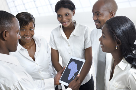 African business team discussing with tablet PC, Studio Shot Stock Photo